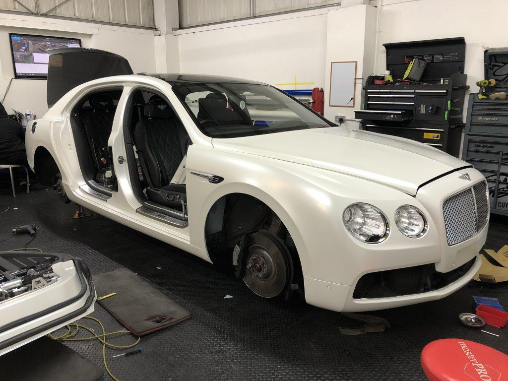 Car wrapping door shuts on a Bentley